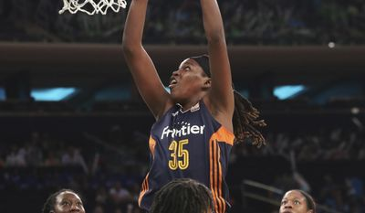 Connecticut Sun forward Jonquel Jones (35) goes to the basket past New York Liberty center Tina Charles (31), guard Epiphanny Prince (10) and center Kia Vaughn (7) during the first half of a WNBA basketball game, Wednesday, July 19, 2017,  at Madison Square Garden in New York. (AP Photo/Mary Altaffer)