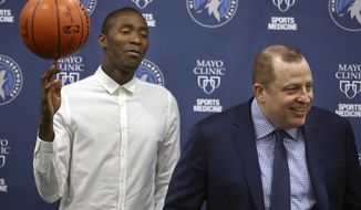 Minnesota Timberwolves' Jamal Crawford balances a basketball as Minnesota Timberwolves president of basketball operations/head coach Tom Thibodeau speaks during a news conference, Wednesday, July 19, 2017 in Minneapolis. (Richard Tsong-Taatarii/Star Tribune via AP)
