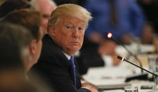 "President Donald Trump listens during a ""Made in America,"" roundtable event in the East Room of the White House, Wednesday, July 19, 2017, in Washington. (AP Photo/Alex Brandon)"