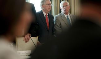 Senate Majority Leader Mitch McConnell of Ky., left, and Sen. Roger Wicker, R-Miss. wait to take their seats for a luncheon with President Donald Trump, Wednesday, July 19, 2017, in the State Dinning Room of the White House in Washington. (AP Photo/Pablo Martinez Monsivais)
