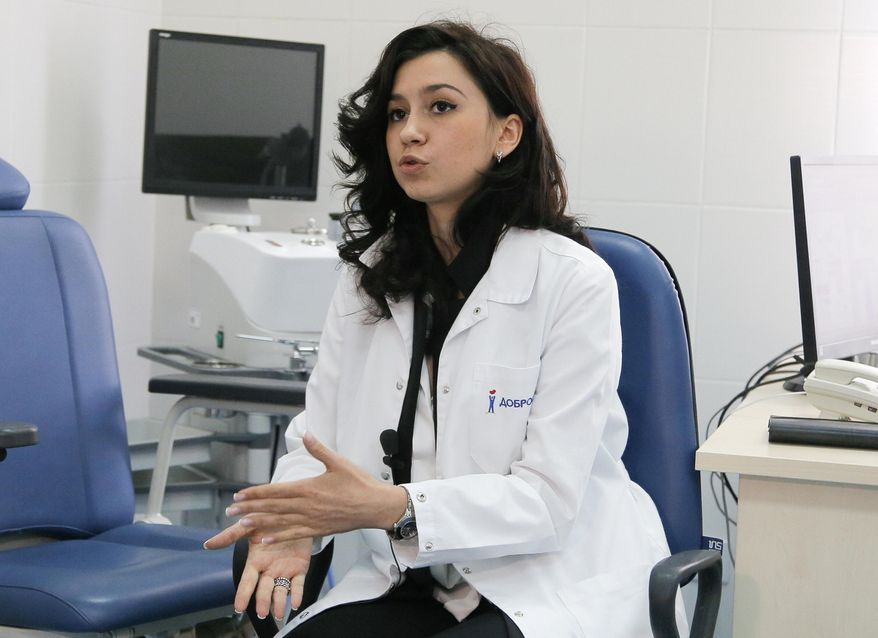 In this photo taken Wednesday, July 5, 2017, Dr. Lidiia Podkopaieva speaks during an interview with The Associated Press at her clinic in Kiev, Ukraine. Podkopaieva's clinic was one of many institutions disrupted by June 27 cyberattack which paralysed computers in Ukraine and across the globe. (AP Photo/Efrem Lukatsky)