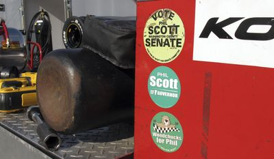In this July 6, 2017 photo, political stickers cover a tool box of Vermont Gov. Phil Scott at the Thunder Road race track in Barre, Vt., where he won A 50-lap feature race, his 30th lifetime win. Scott has been racing for decades and races whenever he can, but spends most of his time working as governor. (AP Photo/Wilson Ring)