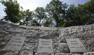 Five women who were hanged as witches 325 years ago at Proctor's Ledge during the Salem witch trials are being remembered in a noon ceremony at the site of their death, pictured here, Wednesday, July 19, 2017, in Salem, Mass. Sarah Good, Elizabeth Howe, Susannah Martin, Rebecca Nurse and Sarah Wildes were hanged as witches on July 19, 1692. It was the first of three mass executions at the site on Proctor's Ledge. (AP Photo/Stephan Savoia)