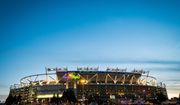 FedEx Field is lit up as fans arrive before the NFL football game between the Washington Redskins and the San Francisco 49ers in Landover, Monday, Nov. 25, 2013. (AP Photo/J. David Ake)