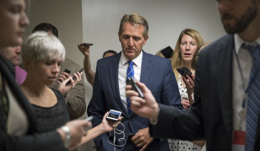 Sen. Jeff Flake, R-Ariz., heads to the chamber for a vote, on Capitol Hill in Washington, Thursday, July 20, 2017. Majority Leader Mitch McConnell is spurring Republican senators to resolve internal disputes that have pushed their marquee health care bill to the brink of oblivion, a situation made more difficult for the GOP because of Sen. John McCain's jarring diagnosis of brain cancer. (AP Photo/J. Scott Applewhite)