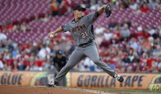 Arizona Diamondbacks starting pitcher Zack Greinke throws in the second inning of a baseball game against the Cincinnati Reds, Wednesday, July 19, 2017, in Cincinnati. The Reds won 4-3. (AP Photo/John Minchillo)