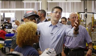House Speaker Paul Ryan, R-Wis., gestures to employees as he takes a tour of the manufacturing floor at a New Balance athletic shoe factory Thursday, July 20, 2017, in Lawrence, Mass. (AP Photo/Stephan Savoia)