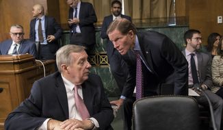 Sen. Dick Durbin, D-Ill., left, confers with Sen. Richard Blumenthal, D-Conn., as the Senate Judiciary Committee meets to to advance the nomination of Christopher Wray, President Donald Trump's pick to lead the FBI, on Capitol Hill in Washington, Thursday, July 20, 2017. (AP Photo/J. Scott Applewhite)