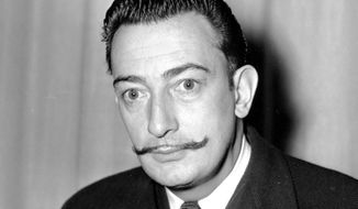 In this file photo taken on Nov. 4, 1942, Spanish surrealist painter, Salvador Dali is pictured in New York. Dali's eccentric artistic and personal history took yet another bizarre turn Thursday, July 20, 2017, with the exhumation of his embalmed remains in order to find genetic samples that could settle whether one of the founding figures of surrealism fathered a girl decades ago. (AP Photo, File)