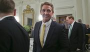 Sen. Jeff Flake, R-Ariz., center, walks to his seat as he attends a luncheon with other GOP Senators and President Donald Trump, Wednesday, July 19, 2017 in the State Dinning Room of the White House in Washington. Also in the room is Sen. Richard Shelby, R-Ala., right. (AP Photo/Pablo Martinez Monsivais)