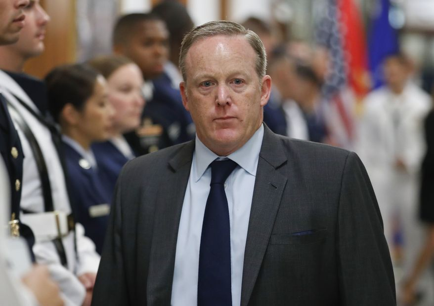 White House press secretary Sean Spicer walks down the hallway during President Donald Trump's visit to the Pentagon, Thursday, July 20, 2017. (AP Photo/Pablo Martinez Monsivais)
