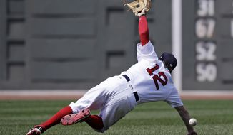 Boston Red Sox second baseman Brock Holt dives but can't make the play on a single by Toronto Blue Jays's Steve Pearce during the third inning of a baseball game at Fenway Park in Boston, Thursday, July 20, 2017. (AP Photo/Charles Krupa)