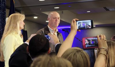 FILE - In this May 25, 2017 file photo, Republican Greg Gianforte greets supporters at a hotel ballroom after winning Montana's sole congressional seat, in Bozeman, Mont. In his speech, Gianforte apologized for an altercation at his campaign headquarters with a reporter on the eve of the special election. A Montana prosecutor asked a judge Thursday, July 20 to require Gianforte to be fingerprinted and photographed after he pleaded guilty to assaulting the reporter, Ben Jacobs of The Guardian. Gianforte was sentenced to community service and ordered to undergo anger management counseling. (AP Photo/Bobby Caina Calvan, File)