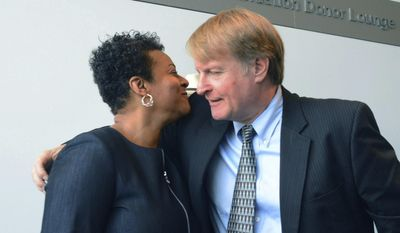 Allegheny County Executive Rich Fitzgerald congratulates Janis Burley Wilson after she was introduced as the new president and CEO of the August Wilson Center in Pittsburgh, Pa., Thursday, July 20, 2017. The August Wilson Center for African American Culture is a non-profit organization that presents theatre and music performances and visual arts programs. (Lake Fong/Pittsburgh Post-Gazette via AP)