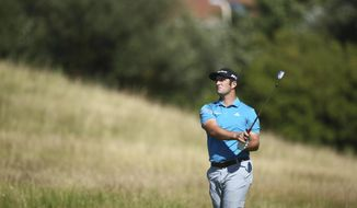 Spain's Jon Rahm plays a shot on the 5th hole during the first round of the British Open Golf Championship, at Royal Birkdale, Southport, England Thursday, July 20, 2017. (AP Photo/Dave Thompson)