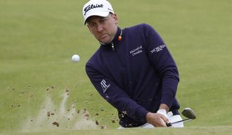 England's Ian Poulter chips out of a bunker onto the 17th green during the first round of the British Open Golf Championship, at Royal Birkdale, Southport, England Thursday, July 20, 2017. (AP Photo/Alastair Grant)