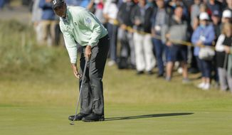 Matt Kuchar of the United States prepares to putt on the 14th green during the first round of the British Open Golf Championship, at Royal Birkdale, Southport, England Thursday, July 20, 2017. (AP Photo/Alastair Grant)