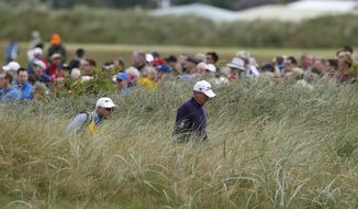England's Ian Poulter walks along the 12th hole during the first round of the British Open Golf Championship, at Royal Birkdale, Southport, England Thursday, July 20, 2017. (AP Photo/Alastair Grant)