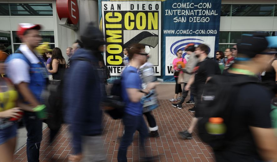 People arrive for the first day of Comic-Con Thursday, July 20, 2017, in San Diego. Comic-Con, which started as a comic-book convention with 300 participants in 1970 and has grown into a corporate-heavy media showcase that draws more than 130,000 attendees, runs through Sunday in San Diego. (AP Photo/Gregory Bull)