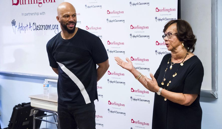Musician and actor Common and his mother Dr. Mahalia Hines visit the Renaissance School of the Arts as Ambassadors for AdoptAClassroom.org and Burlington Stores on Thursday, July 20, 2017, in New York. Common will be fulfilling all the wish lists that teachers and faculty put together for the school's needs for the upcoming year. (Photo by Charles Sykes/Invision/AP)