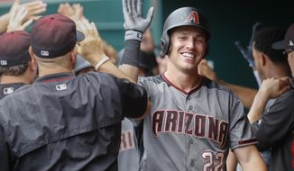 Arizona Diamondbacks' Jake Lamb (22) celebrates in the dugout after hitting a three-run home run off Cincinnati Reds starting pitcher Luis Castillo in the first inning of a baseball game, Thursday, July 20, 2017, in Cincinnati. (AP Photo/John Minchillo)