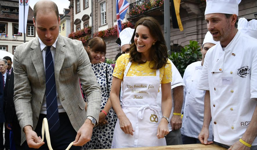 Britain's Prince William, 2nd left, and his wife Kate, the Duchess of Cambridge, form pastry to pretzels as they visit the market in the historic center of the southern German town of Heidelberg, Thursday, July 20, 2017. The British Royal couple and their children are on a three-day-visit to Germany. (Thomas Kienzle/Pool Photo via AP)