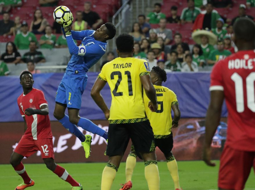 Jamaica goalkeeper Andre Blake grabs the ball during a CONCACAF Gold Cup quarterfinal soccer match against Canada, Thursday, July 20, 2017, in Glendale, Ariz. (AP Photo/Matt York)