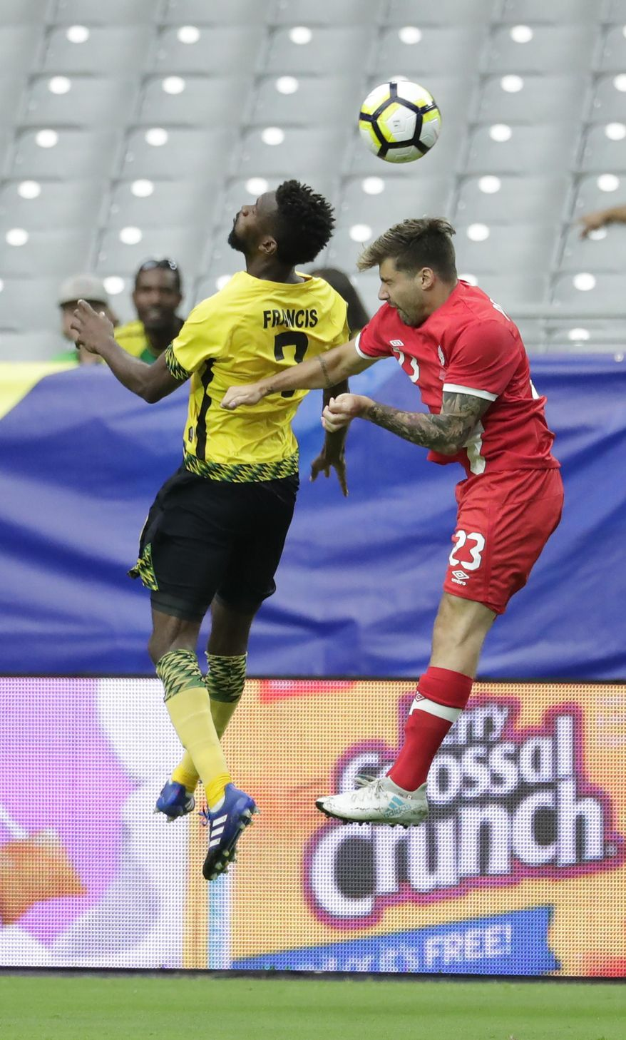 Jamaica's Shaun Francis, left, goes for a header with Canada's Michael Petrasso during a CONCACAF Gold Cup quarterfinal soccer match, Thursday, July 20, 2017, in Glendale, Ariz. (AP Photo/Matt York)
