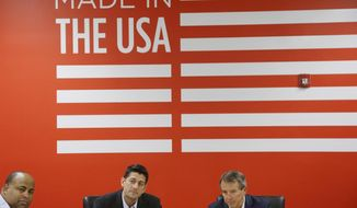 House Speaker Paul Ryan, R-Wis., meets with local business leaders and politicians at the top of a roundtable discussion at a New Balance athletic shoe factory Thursday, July 20, 2017, in Lawrence, Mass, as New Balance President and CEO Rob DeMartini. right, and Lawrence Mayor Dan Rivera, left, listen. (AP Photo/Stephan Savoia)