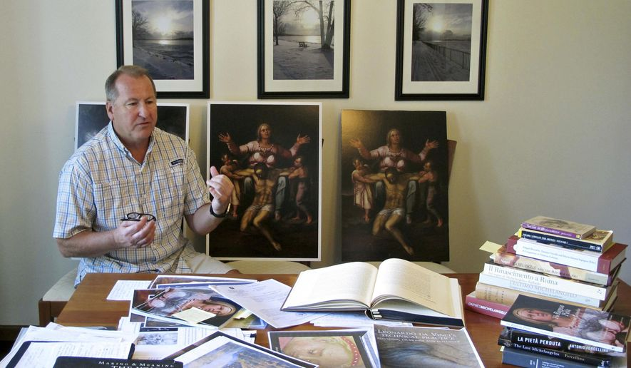 In this June 26, 2017 photo, Martin Kober displays literature and copies of a family heirloom that he believes was painted by Renaissance master Michelangelo, at his home in Tonawanda, N.Y. Kober is convinced the painting of a dying Jesus that hung above the mantel in his upstate New York childhood home is the work of Michelangelo. Getting experts to agree remains the $300 million hurdle. (AP Photo/Carolyn Thompson)