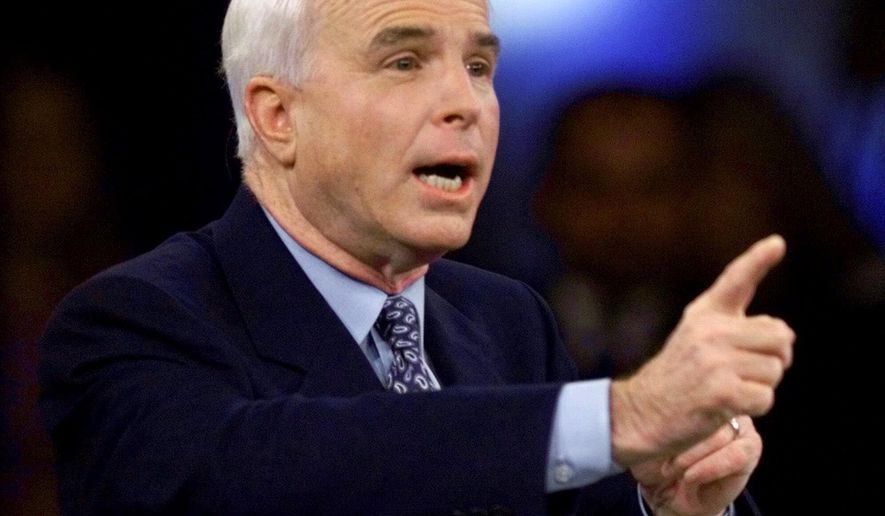 FILE - In this Feb. 15, 2000, file photo photo, then-Republican presidential candidate Sen. John McCain, R-Ariz., responds to a question during the Republican presidential debate sponsored by the South Carolina Business and Industry Political Education Committee, in Columbia, S.C. (AP Photo/Eric Draper, Pool)