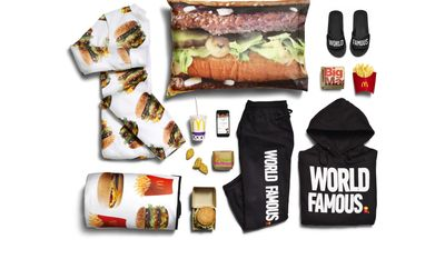 "This photo provided by McDonald's shows the company's McDelivery Collection, a new clothing line that includes an adult-size Big Mac onesie. McDonald's describes the McDelivery Collection as ""a selection of fun, fashion forward items you can wear or use whenever and wherever you order."" It also includes french fry-themed sweatsuits and sandals, hamburger pillowcases and a picnic blanket dotted with McDonald's items. (Courtesy of McDonald's via AP)"