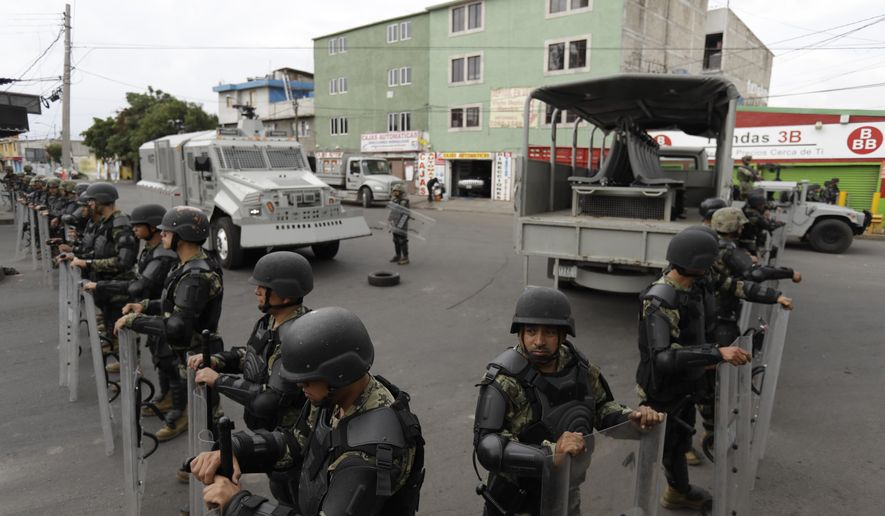 Marines block off the area where the suspected leader of a drug gang and seven others were killed, according to the Navy, in southern Mexico City, Thursday, July 20, 2017. In a statement Thursday, the Navy said a gang of street-level drug dealers operated in the Tlahuac and Iztapalapa districts on the city's south and east sides, where it dealt drugs, as well as carried out kidnappings, extortion and murder. (AP Photo/Rebecca Blackwell)