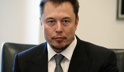 """FILE - In this Dec. 14, 2016, file photo, Tesla CEO Elon Musk listens as President-elect Donald Trump speaks during a meeting with technology industry leaders at Trump Tower in New York. In a Tweet, Musk says he has """"verbal government approval"""" to build a tunnel for high-speed transportation from New York to Washington. The billionaire entrepreneur didn't say who gave him the approval. But the White House confirmed it had """"positive discussions"""" about the tunnel with Musk and executives from his underground drilling enterprise, The Boring Co. (AP Photo/Evan Vucci, File)"""