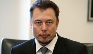 In this Dec. 14, 2016, file photo, Tesla CEO Elon Musk listens as President-elect Donald Trump speaks during a meeting with technology industry leaders at Trump Tower in New York. (AP Photo/Evan Vucci, File)