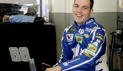 FILE - In this Feb. 17, 2017, file photo, Alex Bowman smiles to team members in his garage during a practice session for a NASCAR auto race at Daytona International Speedway, in Daytona Beach, Fla. Dale Earnhardt Jr. got the replacement he wanted. Alex Bowman got his dream job.Hendrick Motorsports announced Thursday, July 20, 2017, that the 24-year-old Bowman will replace one of the series' biggest stars in the No. 88 car next season after Earnhardt retires. (AP Photo/Terry Renna, File)