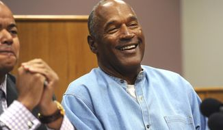 Former NFL football star O.J. Simpson laughs as he appears via video for his parole hearing at the Lovelock Correctional Center in Lovelock, Nev., on Thursday, July 20, 2017.  Simpson was granted parole Thursday after more than eight years in prison for a Las Vegas hotel heist, successfully making his case in a nationally televised hearing that reflected America's enduring fascination with the former football star.  (Jason Bean/The Reno Gazette-Journal via AP, Pool)