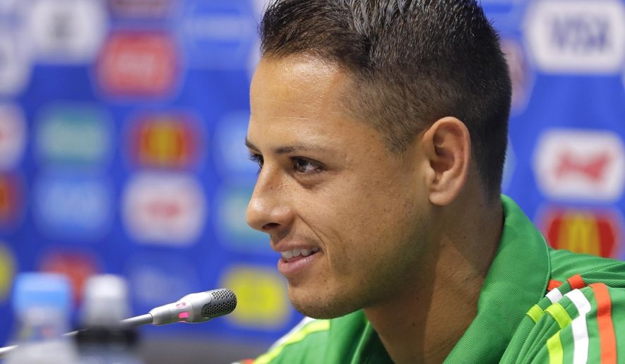 FILE - A Wednesday, June 28, 2017, file photo of  Javier Hernandez speaking during a news conference at the Fisht Stadium in Sochi, Russia.  Hernandez is heading back to the Premier League with West Ham. The London club said Thursday, July 20, 2017,  it has agreed terms with Bayer Leverkusen for the transfer of Hernandez, who was previously at Manchester United from 2010 to 2015. (AP Photo/Sergei Grits, File)