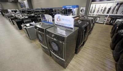 The Kenmore Elite Smart Electric Dryer and Front Load Washer, center, appears on display at a Sears store, Thursday, July 20, 2017, in West Jordan, Utah. Sears will begin selling its appliances on Amazon.com, including smart appliances that can be synced with Amazon's voice assistant, Alexa. Sears, which also owns Kmart, said that its Kenmore Smart appliances will be fully integrated with Amazon's Alexa, allowing users to control things like air conditioners through voice commands. (AP Photo/Rick Bowmer)
