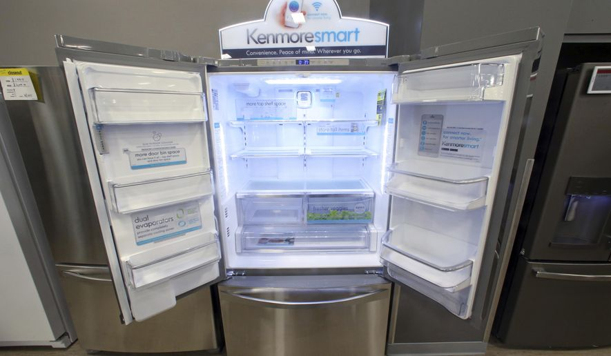 The Kenmore Elite Smart French Door Refrigerator appears on display at a Sears store, Thursday, July 20, 2017, in West Jordan, Utah. Sears will begin selling its appliances on Amazon.com, including smart appliances that can be synced with Amazon's voice assistant, Alexa. Sears, which also owns Kmart, said that its Kenmore Smart appliances will be fully integrated with Amazon's Alexa, allowing users to control things like air conditioners through voice commands. (AP Photo/Rick Bowmer)