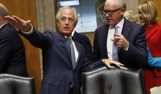 Sen. Bob Corker, R-Tenn., left, shows Woody Johnson, owner of the New York Jets, right, where he should sit, as Johnson arrives for a Senate Foreign Relations Committee hearing on his nomination to be Ambassador to the United Kingdom, Thursday, July 20, 2017, on Capitol Hill in Washington. (AP Photo/Jacquelyn Martin)