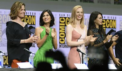 "Sigourney Weaver, from left, Elodie Yung, Deborah Ann Woll, and Jessica Henwick applaud on stage at the ""Marvel's The Defenders"" panel on day two of Comic-Con International on Friday, July 21, 2017, in San Diego, Calif. (Photo by Al Powers/Invision/AP)"