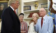 President Donald Trump listens to USS Arizona survivor Donald Stratton, right, during a meeting with survivors of the attack on USS Arizona at Pearl Harbor, in the Oval Office of the White House, Friday, July 21, 2017, in Washington. (AP Photo/Alex Brandon)