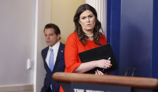 Anthony Scaramucci, incoming White House communications director, left, follows new White House press secretary Sarah Huckabee Sanders into the briefing room at the White House, Friday, July 21, 2017, in Washington. (AP Photo/Alex Brandon)
