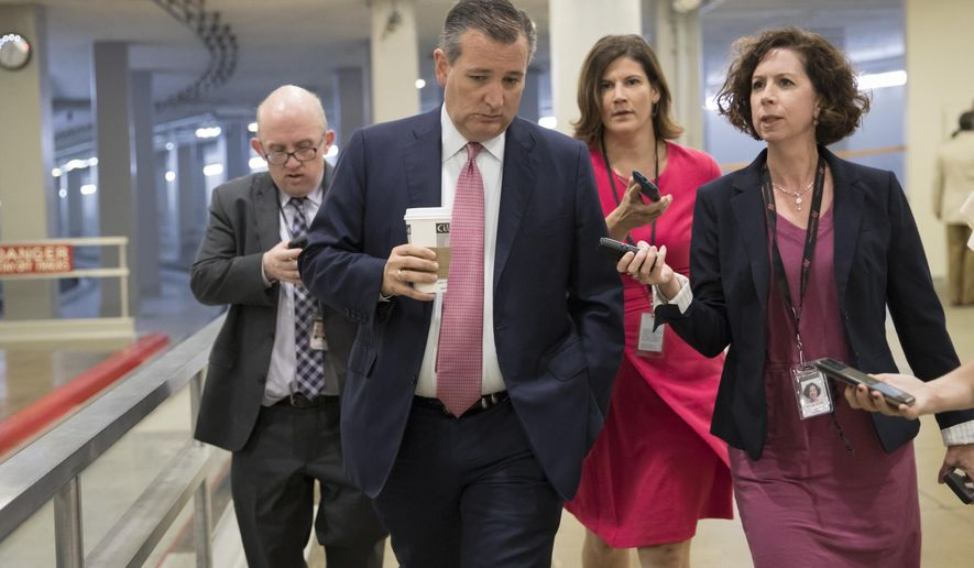 Sen. Ted Cruz, R-Texas, heads to the chamber for a vote, on Capitol Hill in Washington, Thursday, July 20, 2017. Majority Leader Mitch McConnell is spurring Republican senators to resolve internal disputes that have pushed their marquee health care bill to the brink of oblivion, a situation made more difficult for the GOP because of Sen. John McCain's jarring diagnosis of brain cancer. (AP Photo/J. Scott Applewhite)