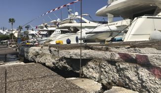 The broken quay wall is raised by several inches in the harbor after an earthquake in Kos on the island of Kos, Greece Friday, July 21, 2017. Greek authorities said two tourists killed in the overnight quake are from Turkey and Sweden.(AP Photo/Michael Probst)