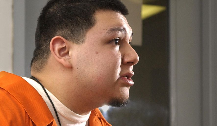 In this Nov. 20, 2004, photo, death-row inmate Erick Vela, one of three men sentenced to death for killing five people at a U.S. Bank branch in Norfolk, Neb., on Sept. 26, 2002, speaks during an interview at the Lincoln Correctional Center awaiting sentencing. The Nebraska Supreme Court on Friday, July 21, 2017, rejected a postconviction appeal by Vela. (Eric Gregory/The Journal-Star via AP)