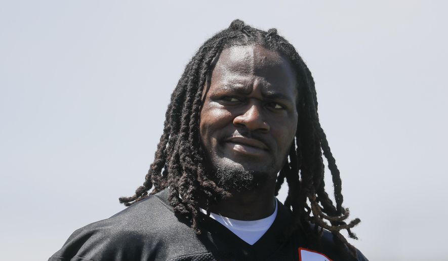 """FILE - In this May 23, 2017, file photo, Cincinnati Bengals cornerback Adam Jones walks the field during organized team activities, in Cincinnati. Bengals cornerback Adam """"Pacman"""" Jones has been suspended for the regular-season opening game after his role in an altercation at a downtown hotel earlier this year. Jones had pleaded guilty to a misdemeanor charge from the January incident, the latest in a history of off-the-field legal issues for the NFL veteran. The NFL said Friday, July 21, 2017, that the suspension was for a violation of its personal conduct policy. (AP Photo/John Minchillo, File)"""
