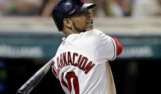Cleveland Indians' Edwin Encarnacion hits an RBI-single off Toronto Blue Jays relief pitcher Jeff Beliveau during the seventh inning of a baseball game, Friday, July 21, 2017, in Cleveland. (AP Photo/Tony Dejak)