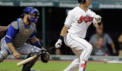 Cleveland Indians' Michael Brantley watches his grounder off Toronto Blue Jays starting pitcher Marco Estrada during the fifth inning of a baseball game, Friday, July 21, 2017, in Cleveland. Brantley was safe at first base, Francisco Lindor was out at second, and Roberto Perez scored. Blue Jays catcher Russell Martin watches. (AP Photo/Tony Dejak)